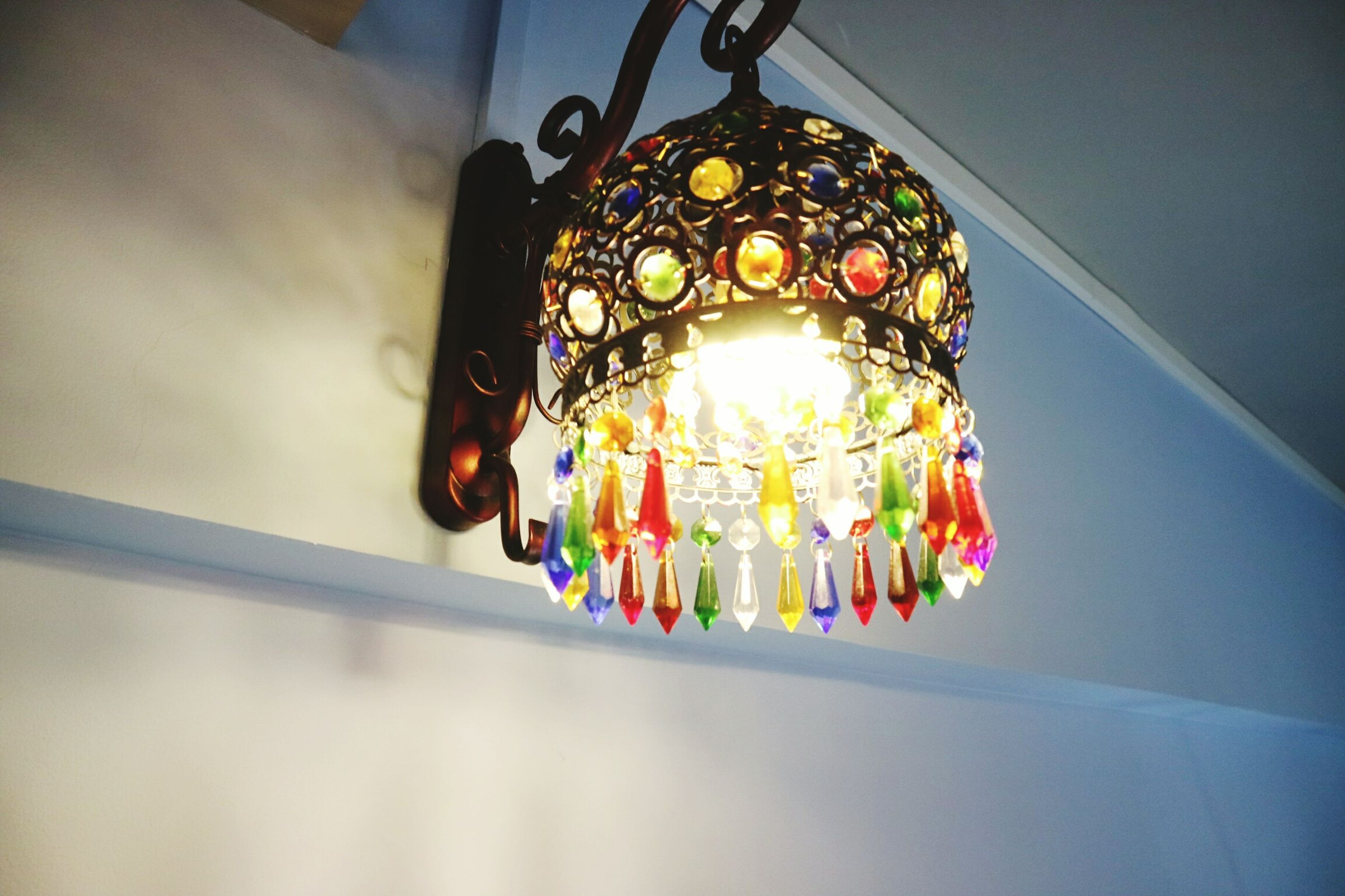 hanging, decoration, low angle view, multi colored, illuminated, indoors, lighting equipment, no people, architecture, close-up, day