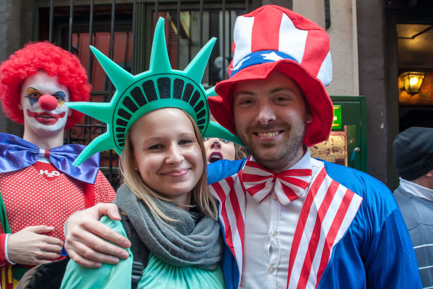 Cologne, Germany - March 14th 2014: Such is the street carnival, a pretty young couple is disguised as Mister America and Miss Liberty American Beautiful Carnival Cologne Couple Disguise Fifth Season Miss Liberty  Mister America Statue Of Liberty Celebration Clown Colorful Costume Dress Up Friendly Joy Looking At Camera Loonies Outdoor Real People Smiling Stars And Stripes Street Carnival Young Adult