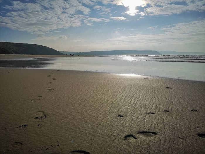 beautiful and calm Perranporth Beach Walk Further Into The Quiet Away From It All Peaceful Wonderful View Autumn Days Water Low Tide Sea Beach Sand Wave Tide Sky FootPrint Track - Imprint Sandy Beach Calm Shore Coastal Feature Coastline Seascape Surf Ocean Horizon Over Water