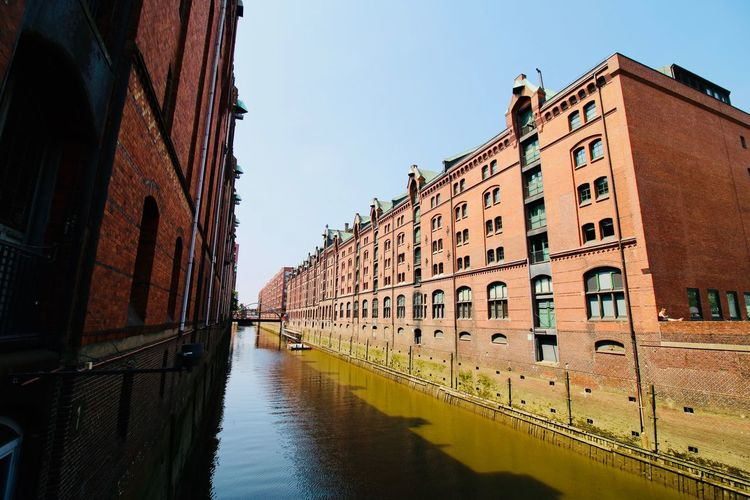 Speicherstadt Hamburg Wide Angle Angled Architecture Speicherstadt Sunny Vacation Germany Hamburg Building Exterior Built Structure Architecture Sky Water Building Nature City Day Clear Sky No People Canal Outdoors Travel Reflection Travel Destinations