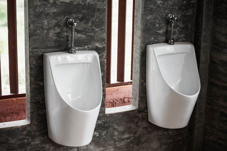 Bathroom Bathtub Clean Day Domestic Bathroom Domestic Room Door Entrance Home Household Equipment Hygiene Indoors  No People Public Building Public Restroom Still Life Toilet Urinal White Color Window Wood - Material
