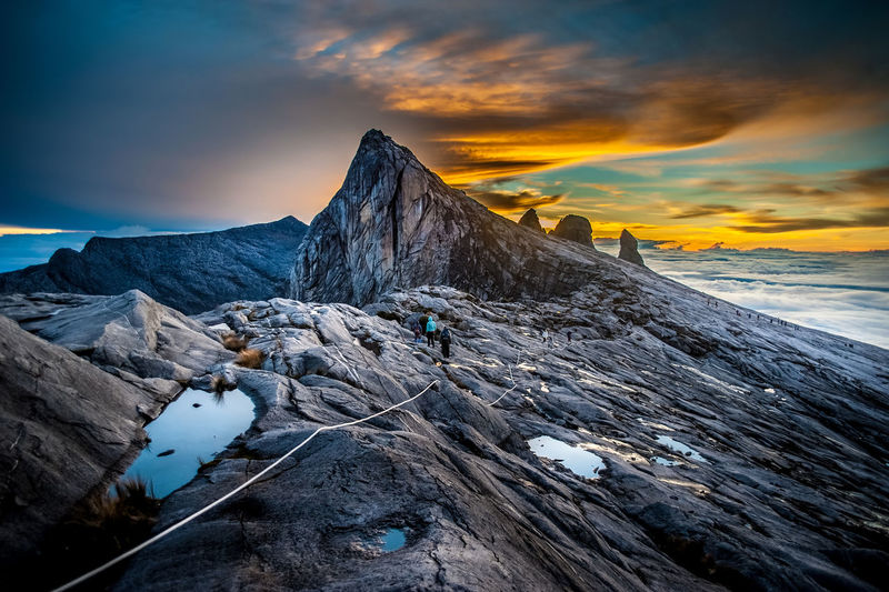 Beauty In Nature Cloud - Sky Cold Temperature Day Flag Glacier Landscape Mountain Mountain Peak Mountain Range Mountain Ridge Mountain Road Nature No People Outdoors Scenics Sky Snow Sunset Tourism Travel Travel Destinations Winter