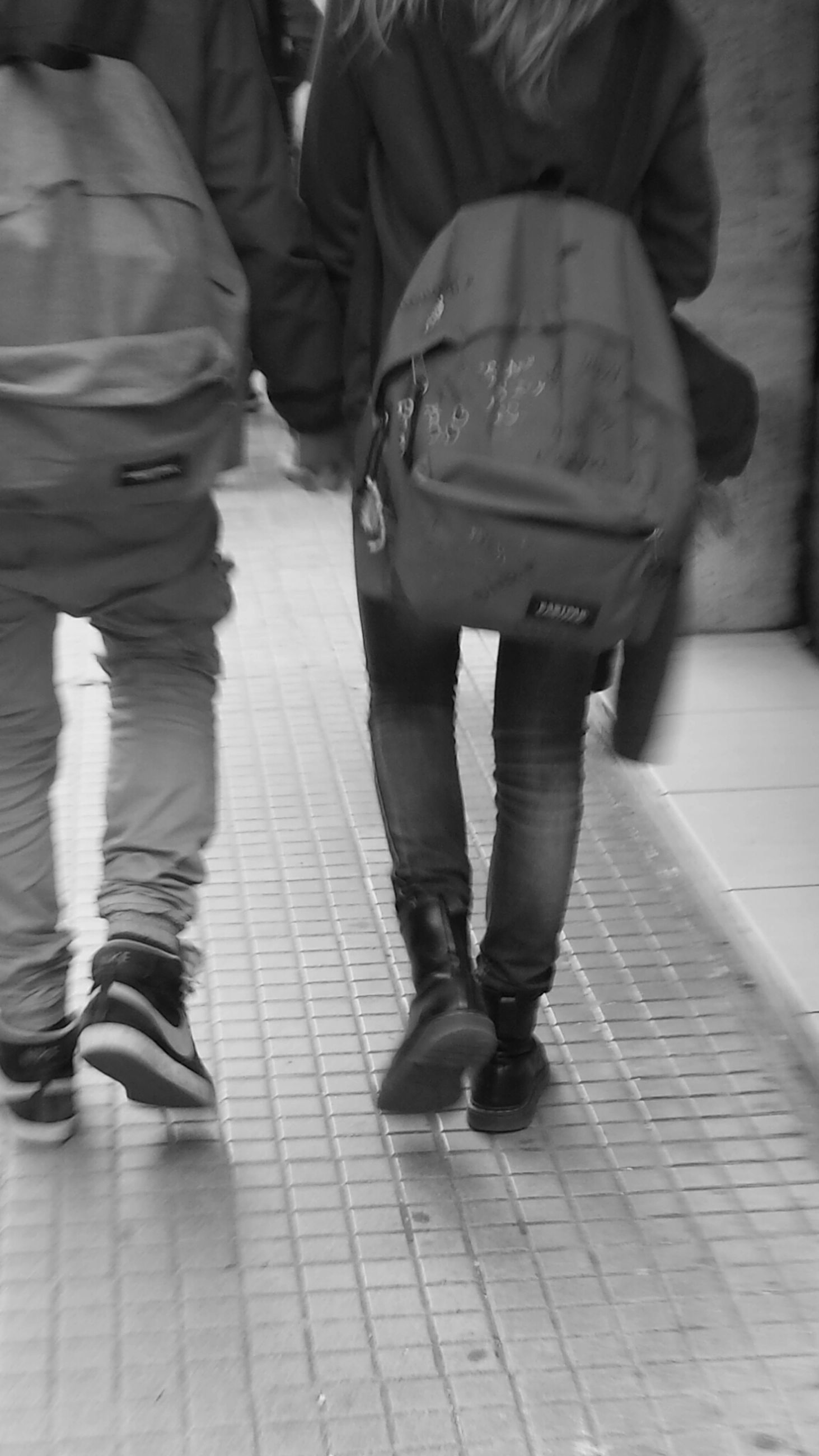 lifestyles, men, casual clothing, standing, walking, leisure activity, rear view, person, low section, full length, togetherness, indoors, street, city life, day, jeans