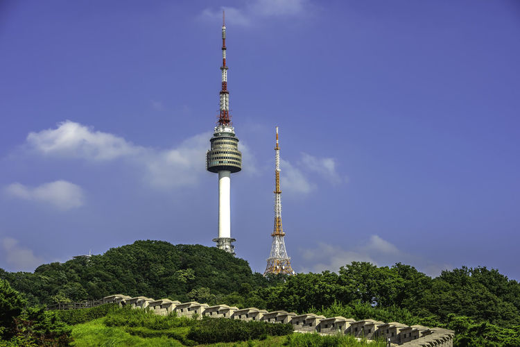 Seoul tower,Namsan tower in korea Architecture Building Exterior Built Structure Cloud - Sky Communication Day Global Communications Low Angle View Nature No People Outdoors Plant Sky Spire  Tall - High Tourism Tower Travel Travel Destinations Tree