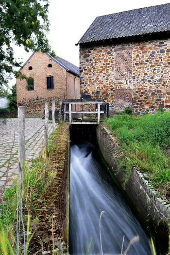 Architecture Built Structure Building Exterior Water Building Nature Motion Long Exposure No People House Plant Day Water Wheel Blurred Motion Fuel And Power Generation Flowing Water Outdoors Watermill Renewable Energy Canal Flowing