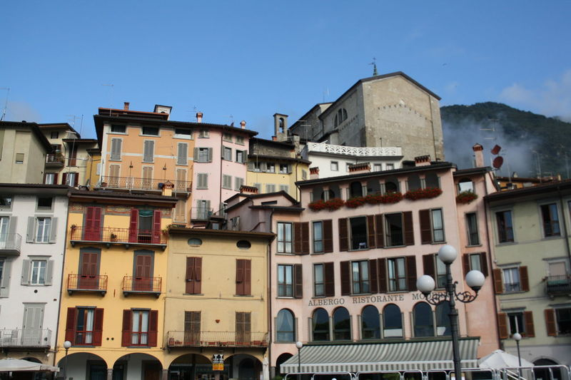 EyeEm EyeEm Gallery EyeEmNewHere Iseo Lake Iseo (italy) Square Architecture Building Exterior Built Structure City Clear Sky Colorful Day Eyem Gallery Iseo Lake Italy Italy❤️ Lake Lake View Lovere No People Outdoors Sky Summer Window