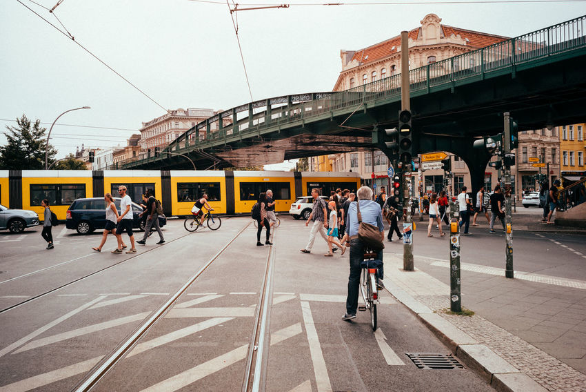 Rush hour City Rush Hour The Street Photographer - 2018 EyeEm Awards Architecture Berliner Ansichten Bridge Bridge - Man Made Structure Building Exterior Built Structure City City Life City Street Crowd Day Group Of People Large Group Of People Lifestyles Men Mode Of Transportation Outdoors Rail Transportation Real People Road Street Transportation Urban