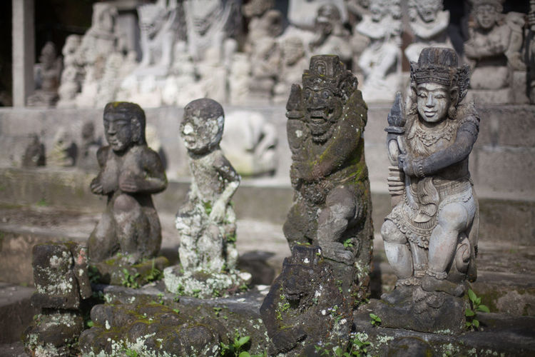 Row of old statues outdoors