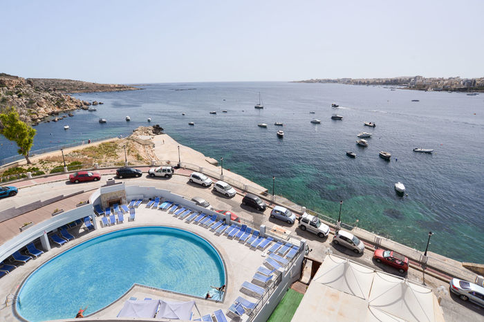 Hot Malta Summertime Architecture Beach Beauty In Nature Blue Clear Sky Day Enjoying Life High Angle View Horizon Over Water Large Group Of People Maltaphotography Maltese Nature Outdoors People Sandy Beach Sea Sky Summer Sun Swimming Pool Tranquility Water