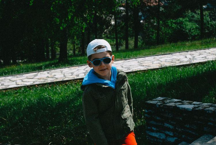 Trendy Boy Standing On Field