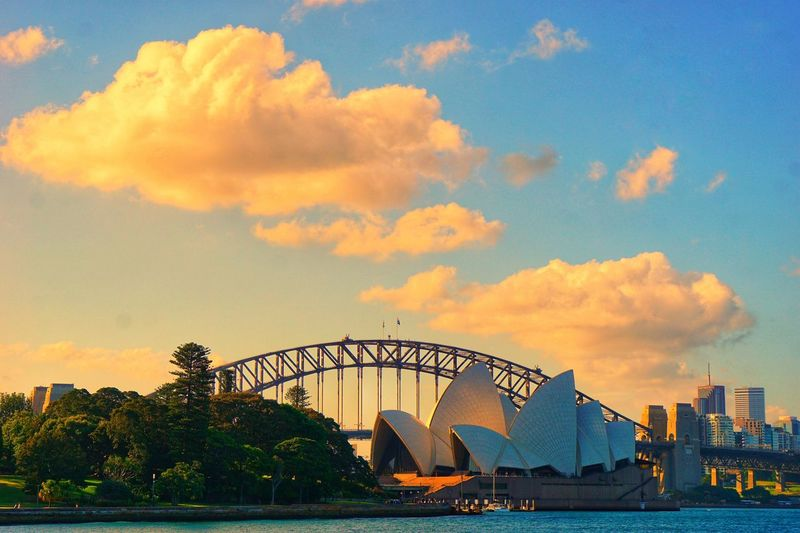 Harbour bridge ans opeea house illuminated by sunset Sunset Portfolio Of Arif Wibowo Photograph By Jgawibowo Portfolio Of Jgawibowo Photography By Jgawibowo Cityscape Architecture Building Exterior City Sunset Popular Music Concert Urban Skyline Arts Culture And Entertainment Sky Architecture Cloud - Sky Amusement Park Opéra Concert Hall  Building Residential Structure Opera House Music Concert Music Festival