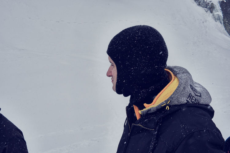 Close-up of a man with snow