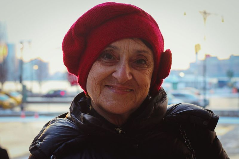 EyeEmNewHere Red Hat Old Age Beautiful People Happy Fullfillment Warm Clothing Portrait Smiling Looking At Camera Headshot Women Red Confidence  Front View Mid Adult Natural Beauty Knit Hat Winter Coat