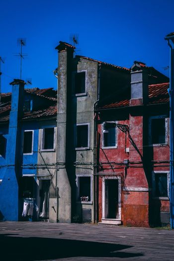 Colored buildings Italy City Burano Architecture Built Structure Building Exterior Abandoned No People Window Outdoors Day Clear Sky Sunlight Blue Sky