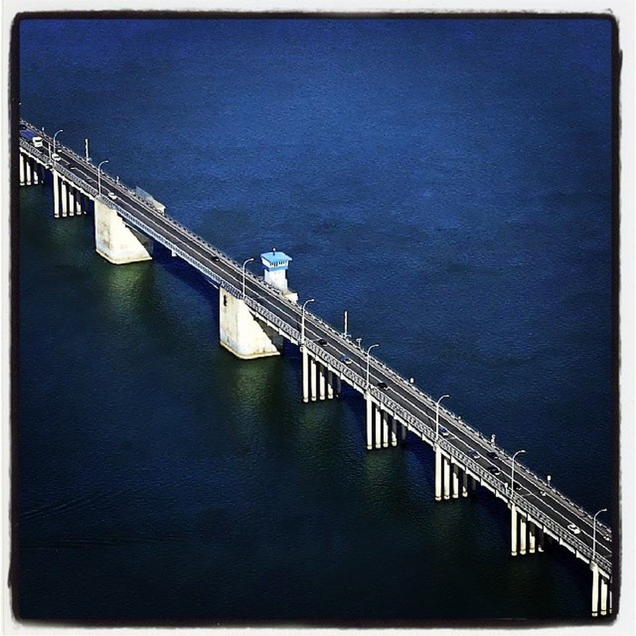 bridge - man made structure, connection, water, railing, architecture, built structure, no people, outdoors, day, industry, blue, nature, sky
