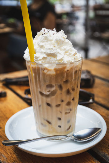 Close-up Coffee Coffee - Drink Dairy Product Drink Drinking Glass Drinking Straw Eating Utensil Focus On Foreground Food Food And Drink Freshness Frothy Drink Glass Household Equipment Indulgence Kitchen Utensil No People Refreshment Still Life Straw Table Temptation Whipped Cream