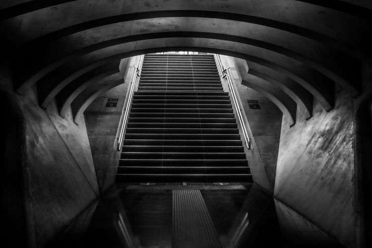 Low angle view of staircase in tunnel