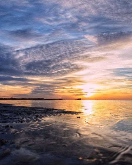 "Sunrise at ""Delta de l'Ebre"" Sunrise Mud Delta De L'Ebre Torre De Sant Joan Water Low Tide Sea Sunset Beach Blue Horizon Reflection Summer Dramatic Sky Tide Romantic Sky Coast Seascape"