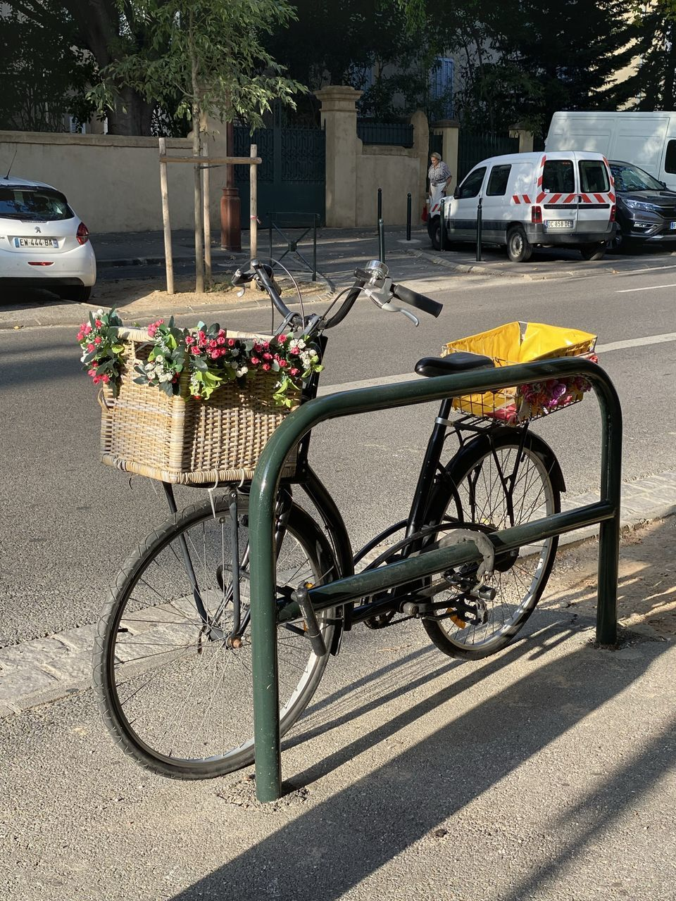 mode of transportation, transportation, land vehicle, car, motor vehicle, bicycle, city, street, road, stationary, basket, nature, day, parking, plant, architecture, sunlight, bicycle basket, flower, no people, outdoors, wheel