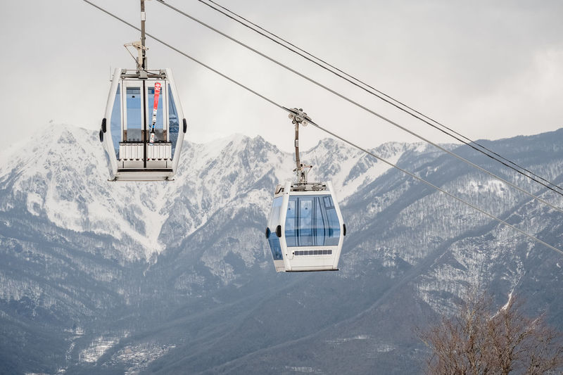 Mountain Cable Car Snow Winter Cold Temperature Overhead Cable Car Mode Of Transportation Transportation Ski Lift Scenics - Nature Cable Beauty In Nature Mountain Range Nature Snowcapped Mountain Sky Day Travel No People Outdoors Mountain Peak