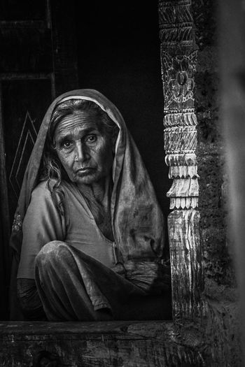 lost. Village Photography Village Life #blackandwhite #indianstreets #raw Village India Pleading Child Childhood Sitting Women Depression - Sadness Sadness