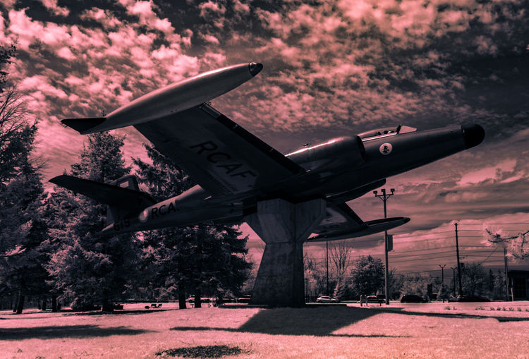 "Avro CF-100 Mk5 ""Canuck"" RCAF Fighter (414 Electronic Warfare Squadron) [IR]. Took this one from the other side of the memento, using my 950nm IR filter. Architecture Check This Out Exceptional Photographs EyeEm Best Shots Hanging Out Hello World Nature Relaxing Taking Photos Tree Airplane Beauty In Nature Canada Coast To Coast Cloud - Sky Day Enjoying Life Eye4photography  First Eyeem Photo Flying History Landscape Light And Shadow Outdoors Sky Skyporn"