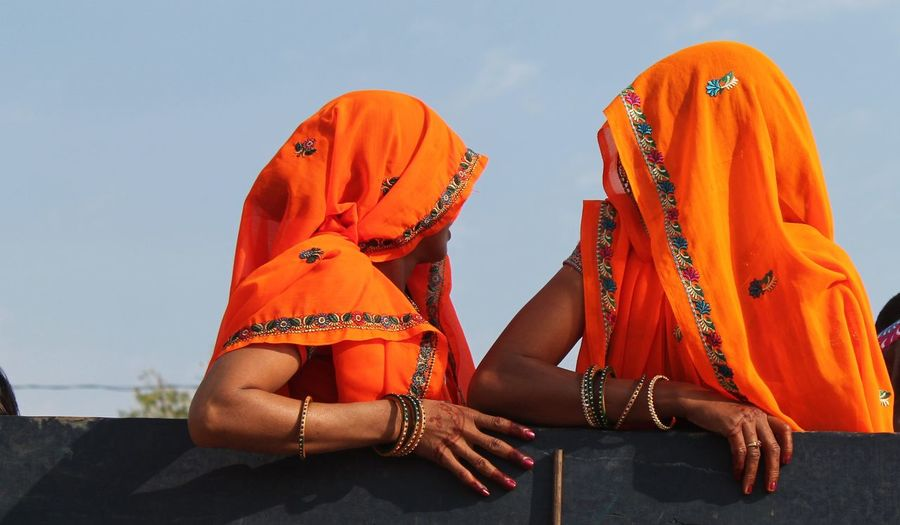 Portrait of two indian women wearing saris