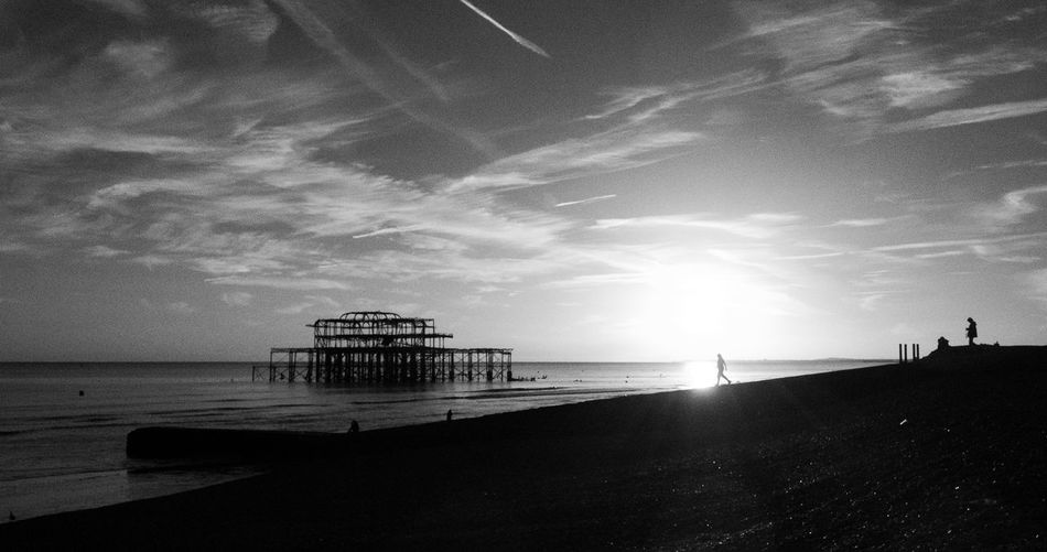 Brighton West Pier Brighton Pier Beach Cloud - Sky Cold Temperature Evening Horizon Over Water Monochrome Outdoors Sea Silhouette Sky Sunlight Tranquil Scene Water My Best Photo
