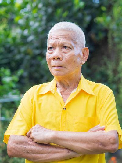 Portrait of mature man standing outdoors