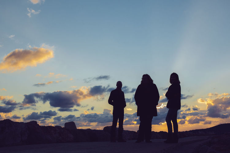 Adult Beauty In Nature Cloud - Sky Friendship Full Length Group Of People Leisure Activity Lifestyles Looking At View Men Nature Outdoors People Real People Rear View Silhouette Sky Standing Sunset Togetherness Women