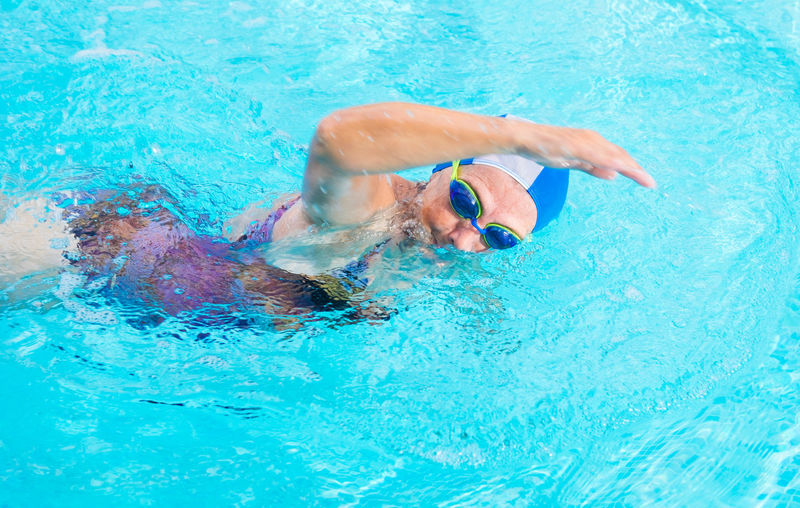 Close-up of senior woman swimming in pool