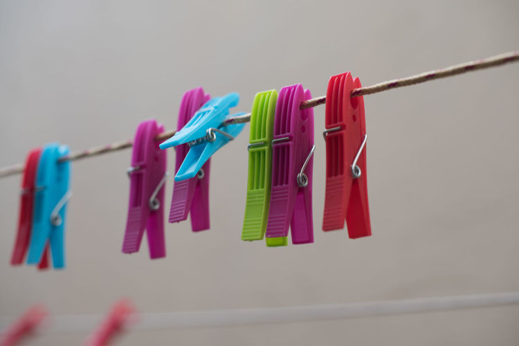 Close-up of multi colored clothespins on clothesline