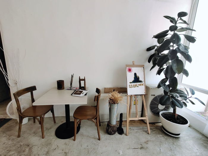 Chairs and tables against wall at home