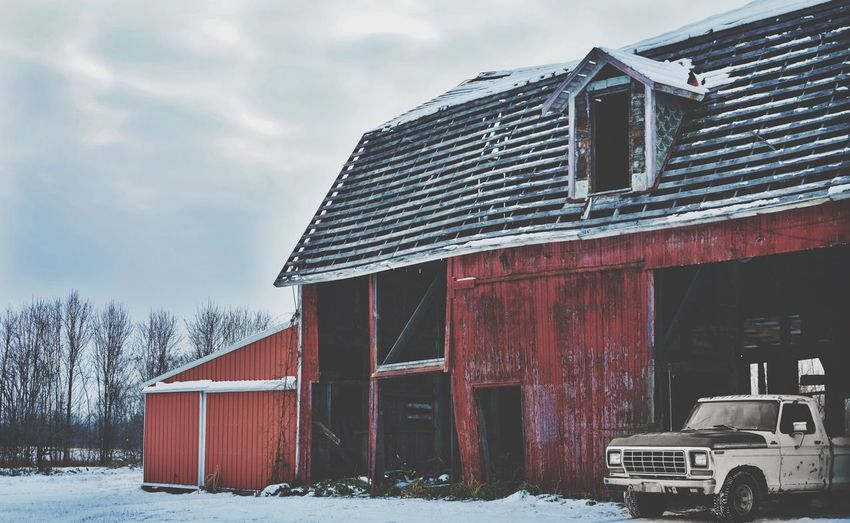 Abandoned barn against sky during winter