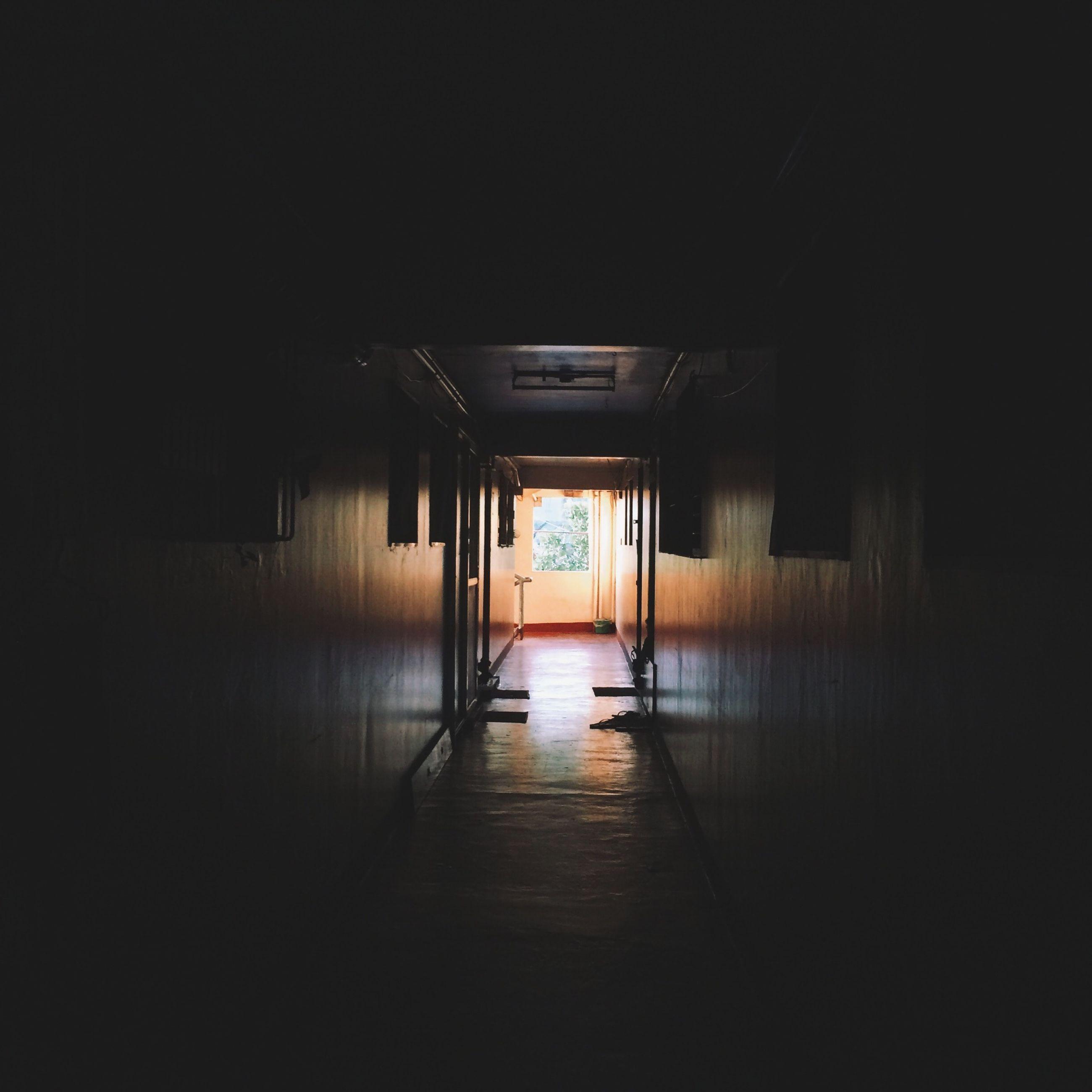 architecture, built structure, indoors, the way forward, corridor, door, illuminated, empty, narrow, dark, entrance, absence, doorway, house, flooring, long, diminishing perspective, building, walkway, no people