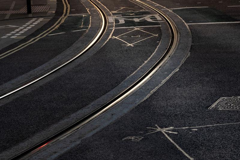 High angle view of railroad tracks on city street