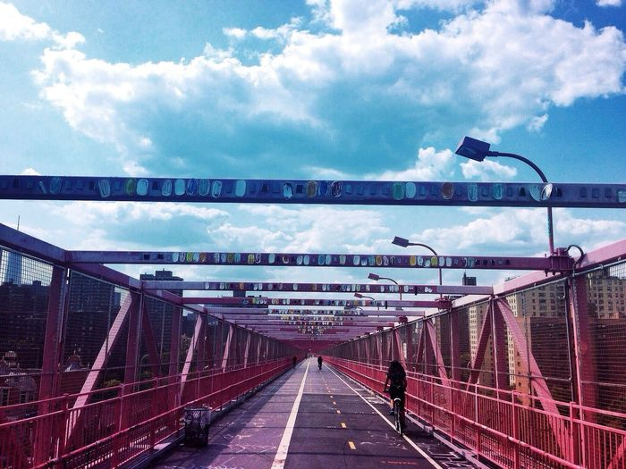 Bridge against cloudy sky