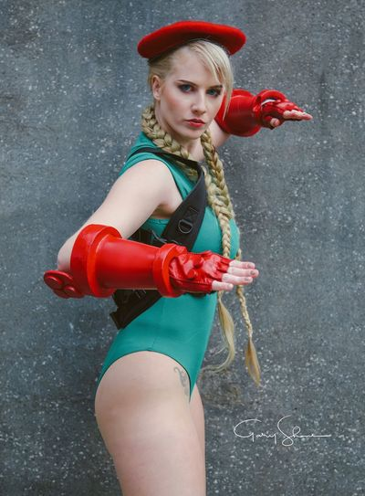 """Looks like I need to update your dossier... from 'fighter' to 'loser'!"" Comic Con Game Street Fighter Cosplayer Cosplay Red One Person Women Clothing Lifestyles Standing Young Adult Beautiful Woman Young Women Fashion"