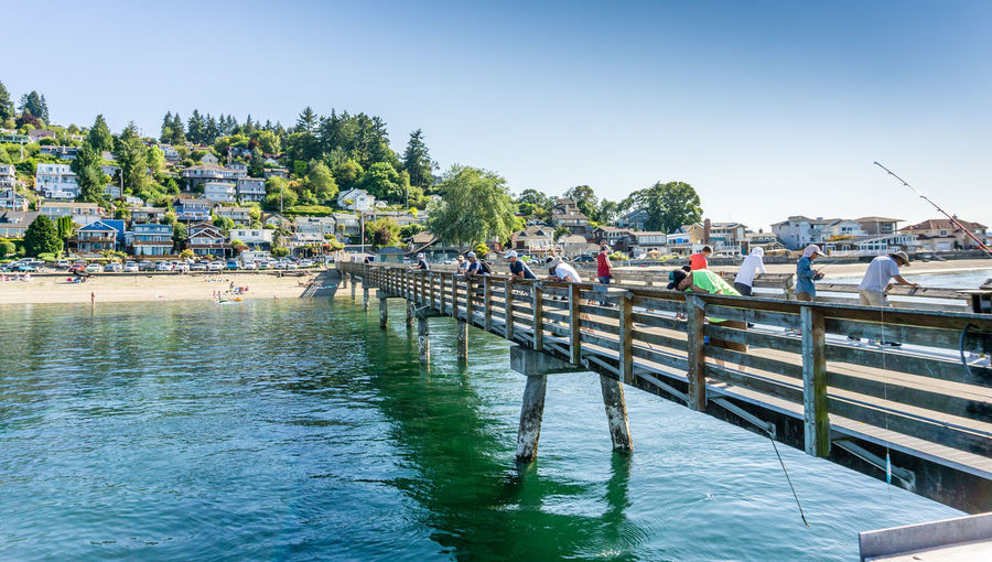 A view from the pier at Dash Point, Washington. Washington State Architecture Beauty In Nature Building Exterior Built Structure Clear Sky Dash Point Day Mode Of Transportation Nature Nautical Vessel Outdoors Pier Plant Railing Real People Sea Sky Transportation Tree Water Waterfront