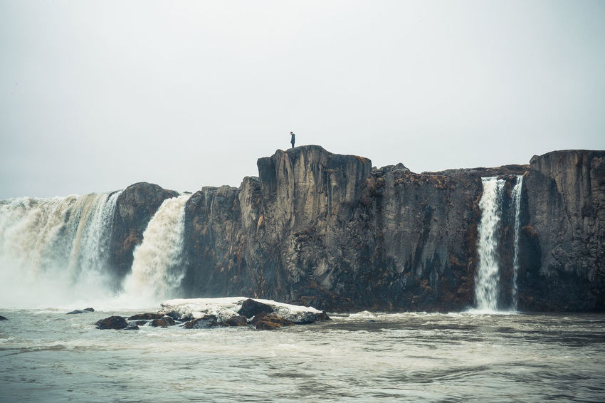 "Goðafoss, the ""waterfall of the gods"", Northeastern Region The river has its origin deep in the Icelandic highland and runs from the highland through the Bárðardalur valley, from Sprengisandur in the Highlands. Around the year 999 the lawspeaker Þorgeir Ljósvetningagoði made Christianity the official religion of Iceland. According to a modern myth, it is said that upon returning from the Alþingi, Þorgeir threw his statues of the Norse gods into the waterfall. Iceland Beauty In Nature Clear Sky Cliff Day Flowing Flowing Water Iceland Trip Iceland_collection Land Long Exposure Motion Nature No People Outdoors Power In Nature Rock Rock - Object Rock Formation Scenics - Nature Sky Solid Water Waterfall Waterfront"