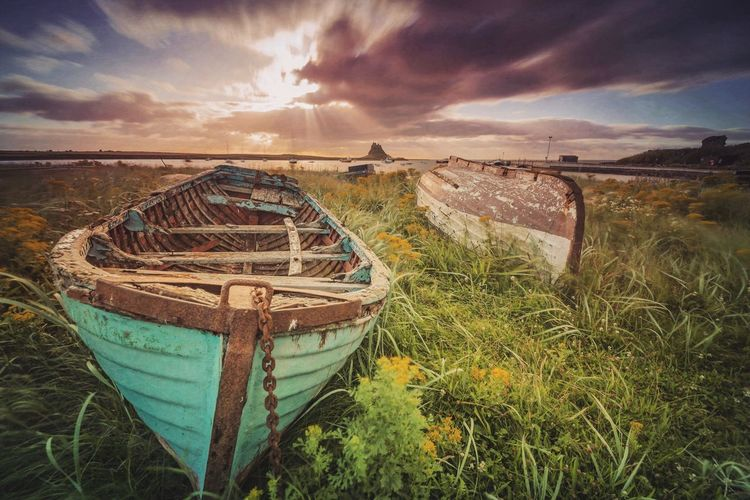 Old Boats On Grass At The Beach