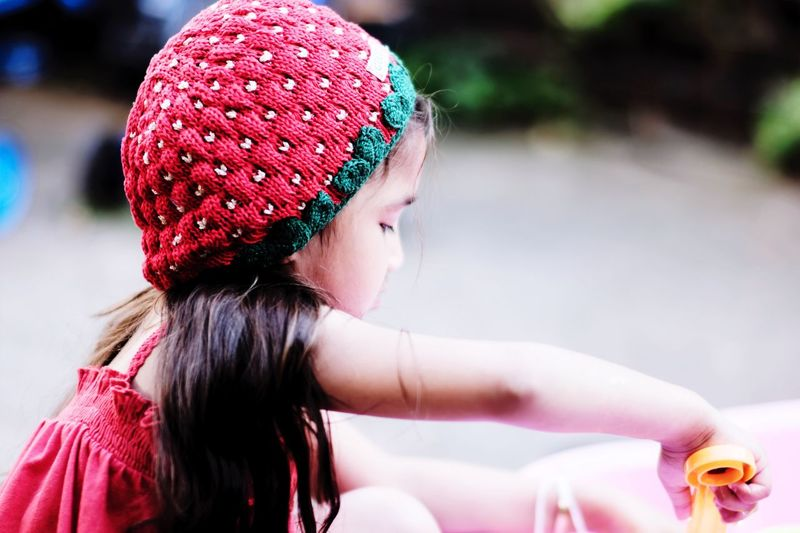 Side view of girl wearing knit hat