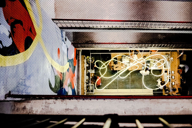 High angle view of graffiti on metal window
