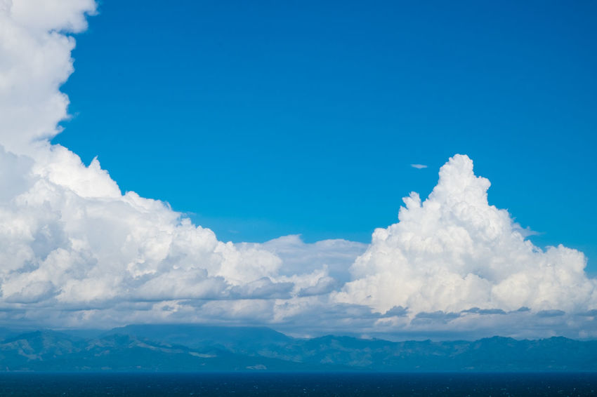 Beauty In Nature Blue Blue Sky Bright Cloud - Sky Copy Space Cumulus Day Fluffy Horizon Mountain Range Nature Outdoors Philippines Scenics Sea Sky Stratocumulus Sunny Tranquil Scene Tranquility Water Perspectives On Nature