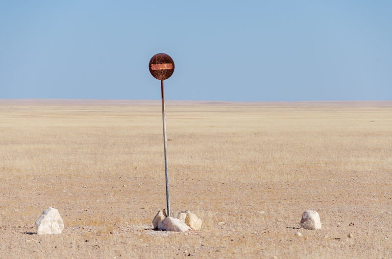 No entry sign in desert against clear sky