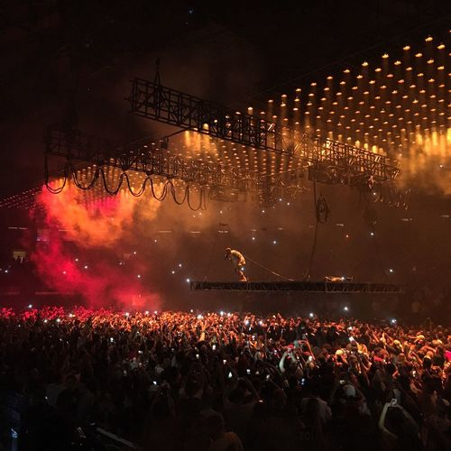 Illuminated Large Group Of People Crowd Arts Culture And Entertainment Celebration Performance Enjoyment Kanye Person Togetherness Lighting Equipment Event Fun Nightlife Spectator Cheering Music Men Lifestyles Atmosphere