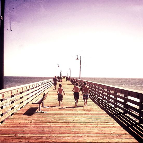 The cusp of summer Childhood Moments Pier Vacations Running Child Enthusiasm Joyful Moments Horizon Over Water Outdoors Sea Live For The Story