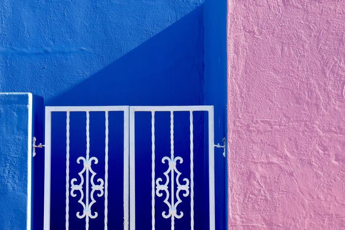 Wall - Building Feature Built Structure Architecture Blue No People Building Exterior Day Outdoors Close-up Pink Color Gate House Street Photography EyeEm Best Shots Check This Out Popular Popular Photos Shadow Lines in Bo-kaap Cape Town , South Africa MISSIONS: The Street Photographer - 2017 EyeEm Awards The Architect - 2017 EyeEm Awards Neon Life Mix Yourself A Good Time The Architect - 2018 EyeEm Awards