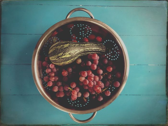 Directly above shot of fruits in colander on table