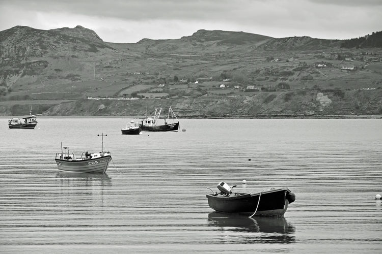 Beauty In Nature Boat Day Lake Mode Of Transport Moored Mountain Mountain Range Nature Nautical Vessel No People North Wales Outdoors Porthdinllaen Beach Scenics Sky Tranquil Scene Tranquility Transportation Water Waterfront